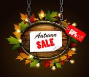Autumn sale wooden signboard Stock Photos