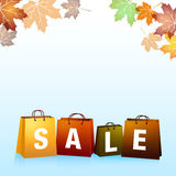 Autumn Sales Background. With leaves and shopping bags Royalty Free Stock Image