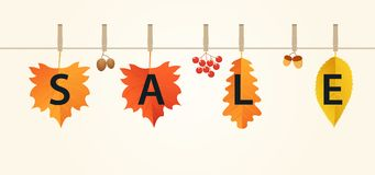 Autumn sales banner with leaves on rope. Autumn composition of red, orange and yellow leaves, acorns, viburnum and pine cones. Royalty Free Stock Image