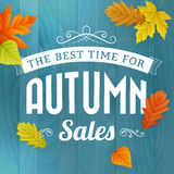 Autumn sales business poster on blue wood background Royalty Free Stock Images