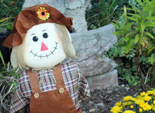 Autumn Scarecrow in the Garden Stock Image