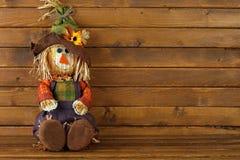 Autumn Scarecrow on wooden background. Autumn, Fall Scarecrow on wooden background Stock Photos