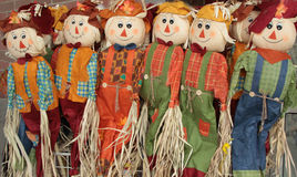 Autumn Scarecrows. Welcoming the Fall Season are these happy Autumn Scarecrows Stock Images