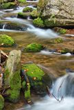 Autumn scene with cascading waterfall Royalty Free Stock Photo