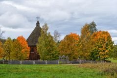 Authentic wooden church Lithuania. Autumn scene of church typical for Aukštaitija region village, 19th century,  Rumsiskes open-air etnographic museum Royalty Free Stock Photography