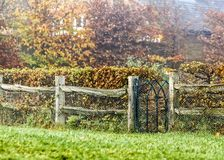 Autumn scene a countryside cottage home with wooden fence and gate royalty free stock photography