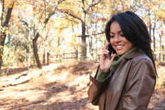 Autumn Scene Fall Woman With Cell Phone royalty free stock photography