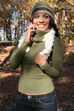 Autumn Scene Fall Woman With Cell Phone royalty free stock photo