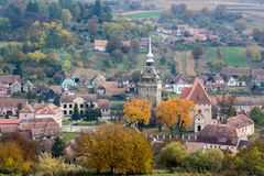 Autumn scene ia a village of Transilvanya. Autumn scene in Saschiz, a beautiful village from Transilvanya. Aerial view with the church and the tower stock photo