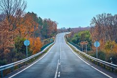 Autumn scene with road in the forest in La Vera, Extremadura. Spain royalty free stock images