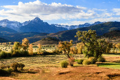 Autumn Scene in the San Juan Mountains. Fields of rolled hay and changing trees with a San Juan Mountain backdrop stock photos