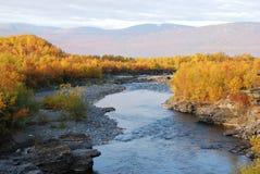 Autumn scenery around river Stock Photos