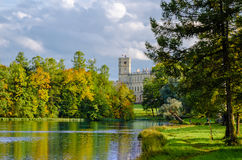 Autumn scenery Gatchina Park with a view of the Palace from the lake. Royalty Free Stock Photography