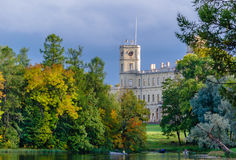 Autumn scenery Gatchina Park with a view of the Palace from the lake. Royalty Free Stock Photo