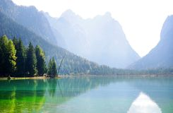 Dobbiaco Lake in the Dolomites Alps, autumn landscape royalty free stock photography