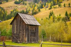 Autumn scenery landscape with colorful forest, wood fences and hay barns in Bucovina, Romania. Autumn scenery landscape, colorful forest, wood fences and hay Stock Photos