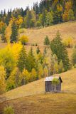 Autumn scenery landscape with colorful forest, wood fences and hay barns in Bucovina, Romania. Autumn scenery landscape, colorful forest, wood fences and hay Stock Image