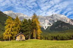 Autumn scenery of Miemenger Plateau with rocky mountains peaks in the background Stock Photo