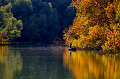 Autumn scenery and tranquil fisherman Stock Photos