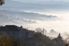 Autumn scenery up early with fog in Zagorochoria, Epirus Greece Royalty Free Stock Images