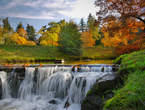 Autumn Scenery Waterfalls Park Landscape. Colorful autumn scenery with waterfalls in the chateau park