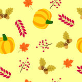 Autumn seamless background with pumpkin, acorns and leaves of maple Royalty Free Stock Photo