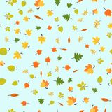 Autumn seamless pattern. With cartoon green, orange and yellow leaves on light blue for wrapping paper. Vector illustration eps 10 Royalty Free Stock Image
