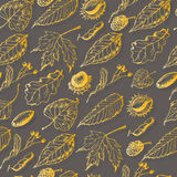 Autumn seamless pattern with leaves and seeds on a gray background Stock Photo