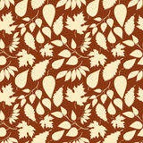 Autumn seamless pattern with leaves silhouettes Stock Photo