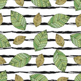 Autumn seamless pattern with modern leaves on stripes texture. Stock Images