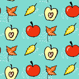 Autumn seamless pattern. Vector background with red apples and maple leaves.  Royalty Free Stock Image
