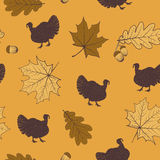 Autumn seamless pattern. Autumn vector seamless pattern with turkey, acorns, leaves of maple and oak on a yellow background Vector Illustration