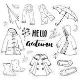 Autumn season clothes set. Hand drawn doodles and lettering vector illustration. Stock Photography