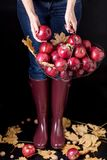 Autumn season concept. The girl in blue jeans and rubber boots Royalty Free Stock Image