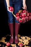Autumn season concept. The girl in blue jeans and rubber boots Royalty Free Stock Photo