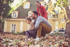 Autumn season is fun for play. Happy family. Stock Photography