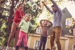 Autumn season is great for playing outside. Family time. Stock Images