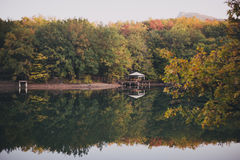 Autumn season landscape, forest and lake Stock Photo
