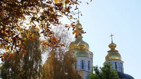Autumn season. Orthodox Christian church and trees. Kyiv. stock video footage