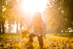 Autumn season - playing child Royalty Free Stock Images