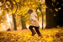 Autumn season - running child Stock Photo