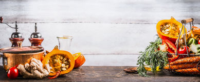 Autumn seasonal cooking concept. Various autumn seasonal organic vegetables: pumpkin,carrot,paprika,tomatoes,ginger in basket on royalty free stock photo