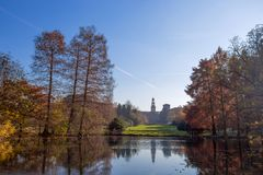 Autumn in Sempione Park with Sforzesco castle on the background in Milan, Italy royalty free stock image