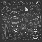 Autumn set of doodles on a chalkboard. Halloween doodles. Autumn doodles on a chalkboard, carved pumpkins, autumn leaves, cakes, candles and apples vector illustration