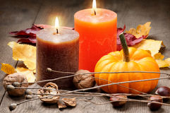 Autumn setting with candles and pumpkin Royalty Free Stock Photography