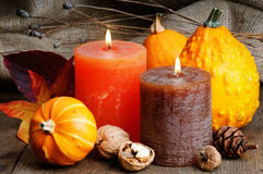Autumn setting with candles and pumpkins Royalty Free Stock Image