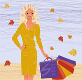 Autumn shopping blonde girl Royalty Free Stock Image