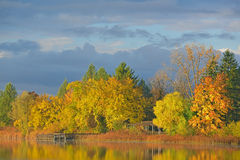 Autumn Shoreline. Of Whitford Lake with reflections in calm water, Fort Custer State Park, Michigan, USA stock photography