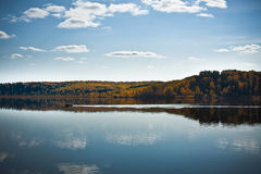Autumn shoreline with beautiful clouds Stock Photography