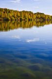 Autumn shoreline with beautiful clouds Royalty Free Stock Photo